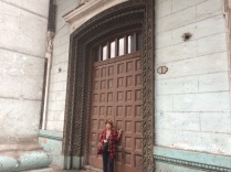 Haydee in front of a huge door