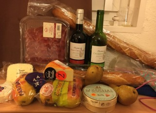 Our purchases, 4 kinds of cheese, 4 apples, 2 pears, 2 baguettes, 2 bottles of wine, and some delicious smoked ham product, total about 32 euros.